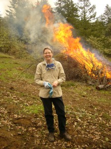Jeanie Taylor burning scotch broom and materials left over from thinning